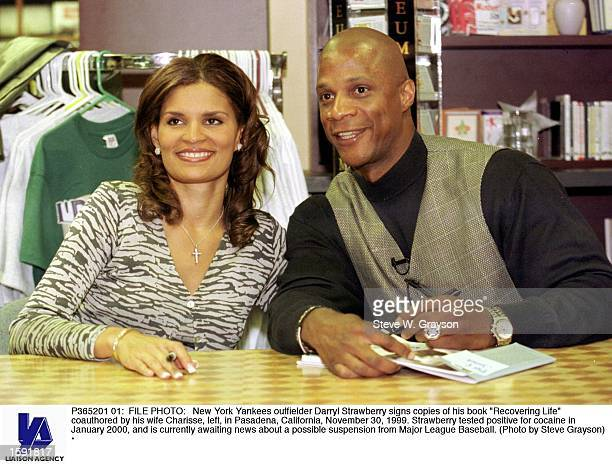 New York Yankees outfielder Darryl Strawberry signs copies of his book Recovering Life coauthored by his wife Charisse left in Pasadena California...