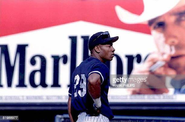 New York Yankees outfielder Gerald Williams waits his turn for batting practice 07 June with a Marlboro cigarette billboard in the background in...
