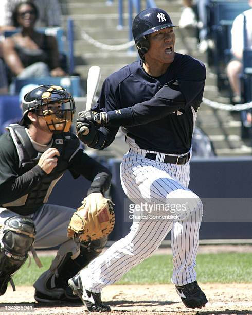 New York Yankees outfielder Hideki Matsui drives the ball deep the Pittsburgh Pirates during a spring training game on March 18 2007 at Legends Field...