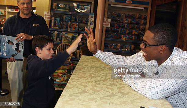 """New York Yankees outfielder, MVP candidate and author Curtis Granderson promotes """"All You Can Be"""" at Bookends Bookstore on November 30, 2011 in..."""