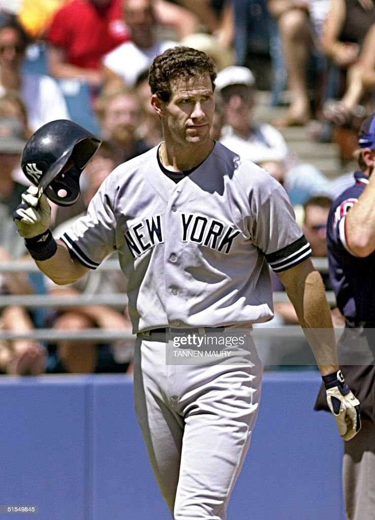 New York Yankees outfielder Paul O'Neill flips his helmet off as he reacts to striking out in the fourth inning against the Chicago White Sox 25 June 2000 in Chicago. O'Neill was ejected from the game for his actions. AFP PHOTO/Tannen MAURY