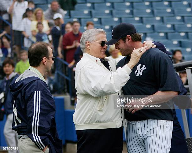 New York Yankees' owner George Steinbrenner embraces infielder Jason Giambi as general manager Brian Cashman looks on during a full squad workout at...
