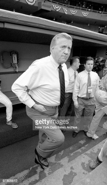 New York Yankees' owner George Steinbrenner leaving the dugout before a game