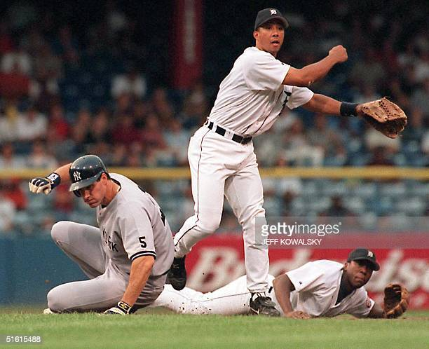 New York Yankees Paul O'Neill is out at second on a hit by Chili Davis to Detroit Tigers shortstop Deivi Cruz rear as Damion Easley fails to complete...