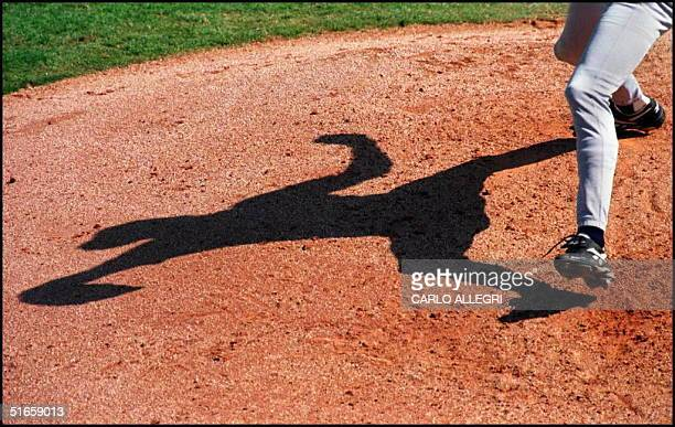 New York Yankees pitcher Brian Boehringer casts a shadow as he pitches against the Toronto Blue Jays in the late innings of their spring training...