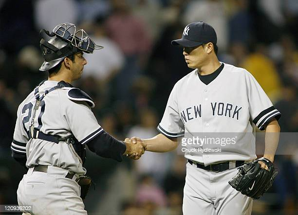 New York Yankees' Pitcher, Chien-Ming Wang is congratulated by Jorge Posada after his complete game 5-1 victory over the Chicago White Sox June 6,...