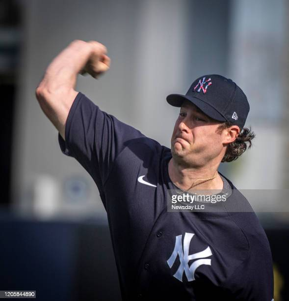 New York Yankees' pitcher Cole Gerrit warming up his arm before throwing in the bullpen on the first day of spring training in Tampa FL Feb 11 2020