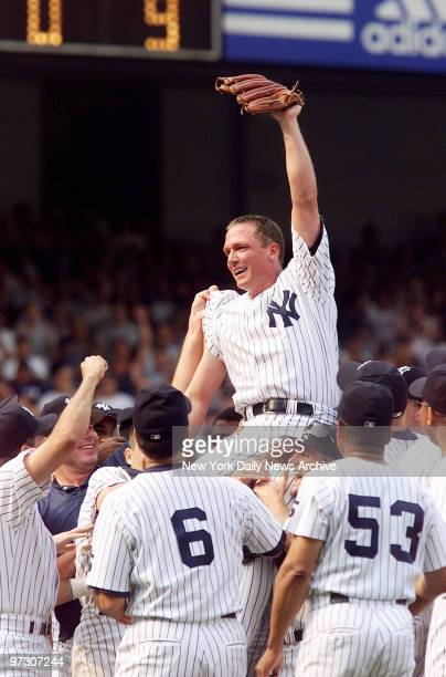 New York Yankees' pitcher David Cone rides on the shoulders of his teammates after pitching a perfect game against the Montreal Expos at Yankee...