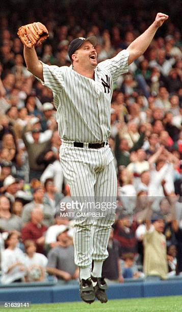 New York Yankees pitcher David Wells reacts as the final out is recorded completing his perfect game against the Minnesota Twins 17 May at Yankee...