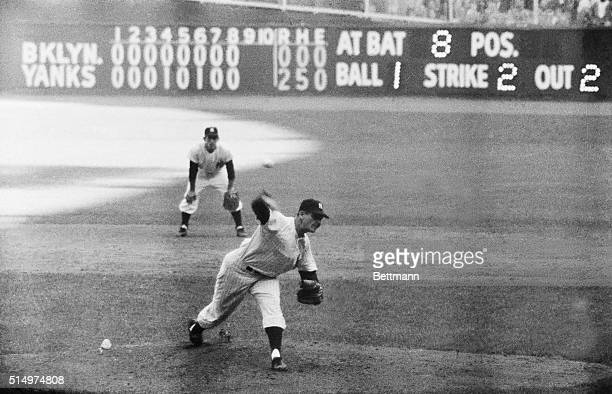 New York Yankee's pitcher Don Larsen delivers a thirdstrike pitch to dodger pinchhitter Dale Mitchell for the final out in the first perfect game in...