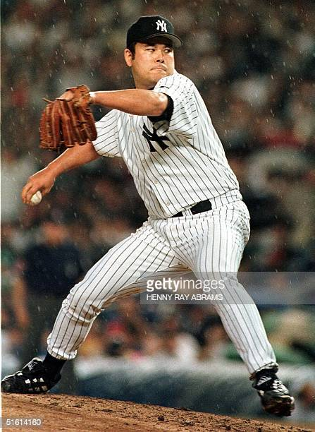 New York Yankees' pitcher Hideki Irabu delivers a pitch in the fourth inning against the Texas Rangers at Yankee Stadium in New York 14 June 1999...