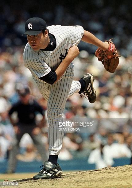 New York Yankees pitcher Hideki Irabu follows through on a pitch during game against the Toronto Blue Jays 04 August 1999 in Yankee Stadium Irabu got...