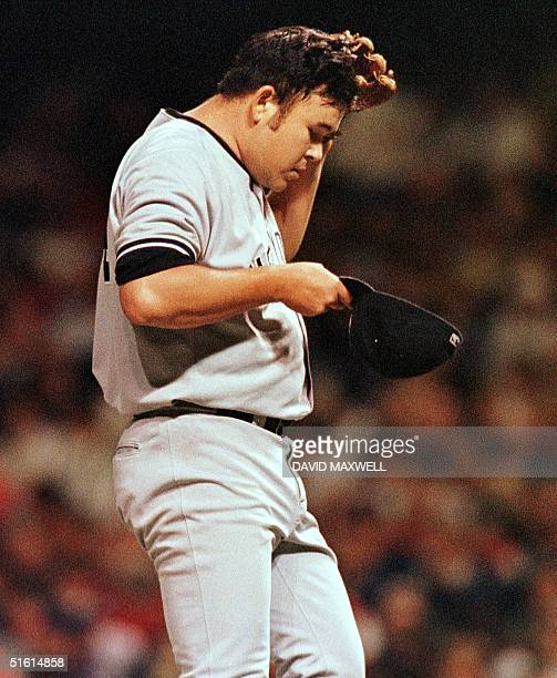 New York Yankees pitcher Hideki Irabu reacts after giving up a two run home run to Cleveland Indians first baseman Jim Thome with one out in the...