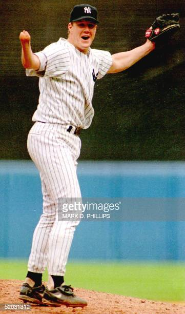 New York Yankees pitcher Jim Abbott celebrates after the last out of New York's first nohitter in 10 years 04 September 1993 Abbott who was born...