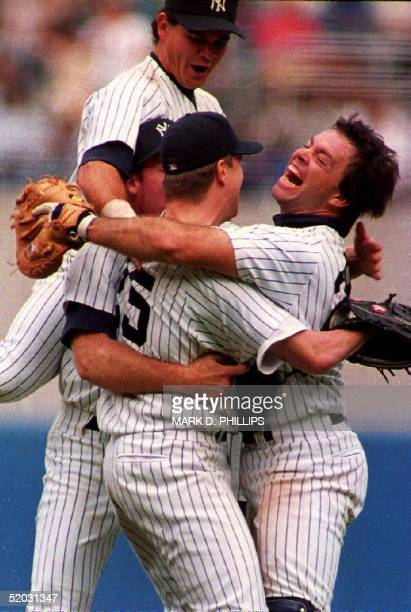 New York Yankees pitcher Jim Abbott is grabbed by catcher Matt Nokes after he completed New York's first nohitter in 10 years 04 September 1993 in...