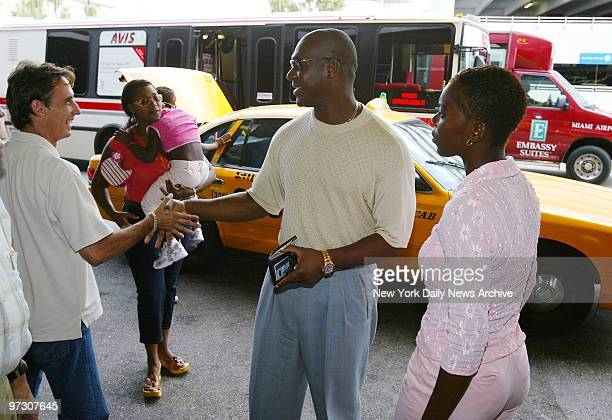 New York Yankees' pitcher Jose Contreras greets a fan on arrival at Miami Airport for a flight to New York with his family Contreras was reunited...