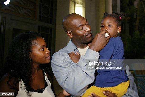New York Yankees' pitcher Jose Contreras holds his 3yearold daughter Naylenis as his wife Miriam looks on at the Loews Hotel in Miami Contreras was...