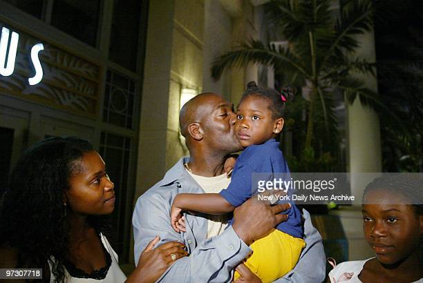 New York Yankees' pitcher Jose Contreras kisses his 3yearold daughter Naylenis as his wife Miriam and daughter Nayalan look on at the Loews Hotel in...