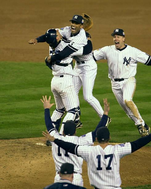 New York Yankees' pitcher Mariano Rivera (c.), catcher Jorge