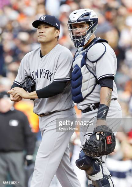 New York Yankees pitcher Masahiro Tanaka and catcher Gary Sanchez talk during the fourth inning of a game against the Baltimore Orioles at Oriole...