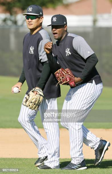 New York Yankees pitcher Masahiro Tanaka and his teammate Luis Severino play around in Tampa Florida on March 14 2018 ==Kyodo