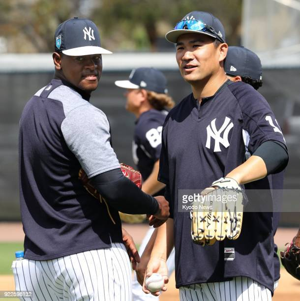 New York Yankees pitcher Masahiro Tanaka chats with his teammate Luis Severino during practice at the team's spring training site in Tampa Florida on...