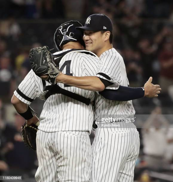 New York Yankees pitcher Masahiro Tanaka is congratulated by catcher Gary Sanchez after throwing his first complete game shutout of the season in a...
