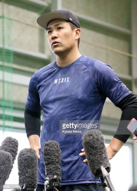 New York Yankees pitcher Masahiro Tanaka speaks to reporters after practice at the home of his former club the Rakuten Eagles in Sendai on Jan 23...