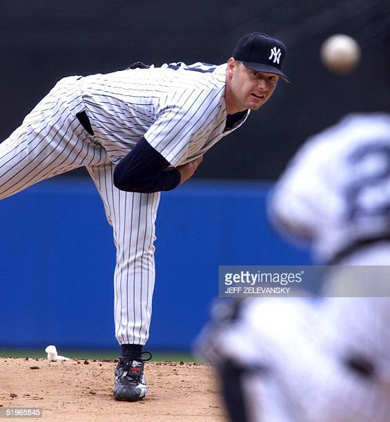 New York Yankees pitcher Roger Clemens throws to catcher Jorge Posada in the first inning against the Boston Red Sox in New York 14 June 2000 Clemens...