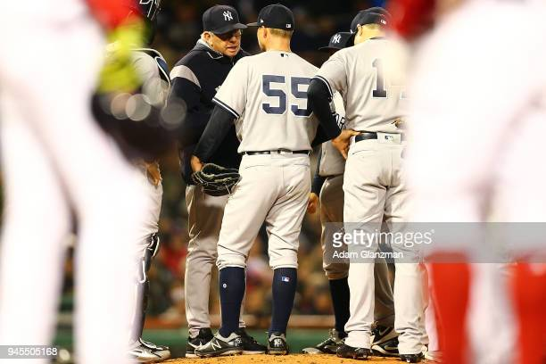 New York Yankees pitching coach Larry Rothschild talks to Sonny Gray of the New York Yankees in the second inning of a game against the Boston Red...