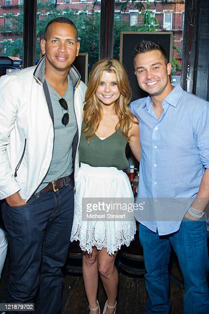 New York Yankees player Alex Rodriguez actress Joanna Garcia Swisher and New York Yankees player Nick Swisher attend the Yankees Unite for Tornado...