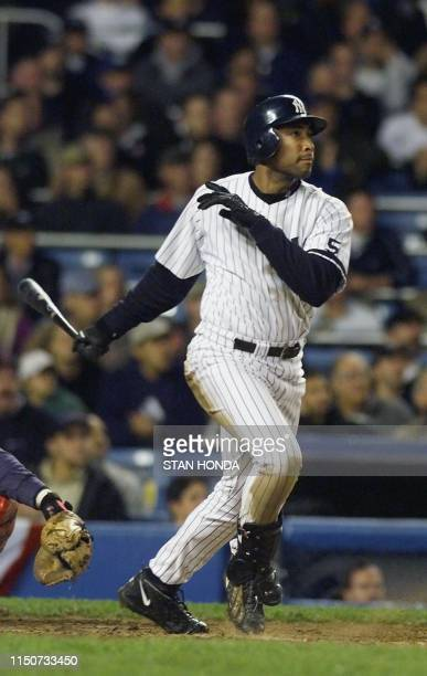 New York Yankees player Bernie Williams watches his tenth inning home run that beat Boston Red Sox 13 October in game one of the American League...