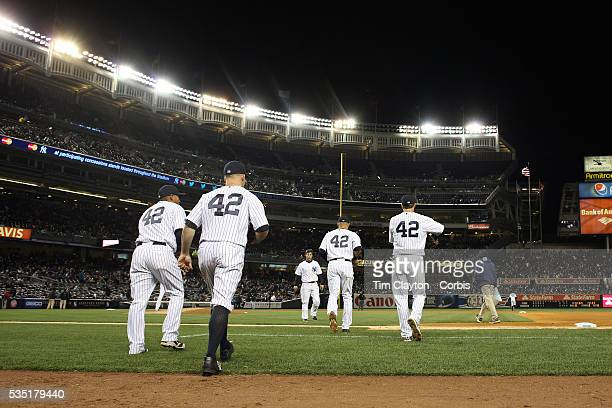 New York Yankees players take the field wearing number 42 during Jackie Robinson Day celebrations during the New York Yankees V Chicago Cubs double...
