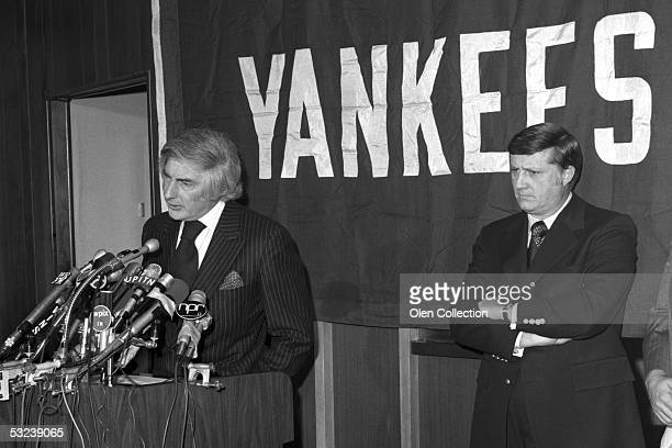 New York Yankees President Michael Burke and George Steinbrenner answer reporters questions as the announcement is made that an ownership group led...