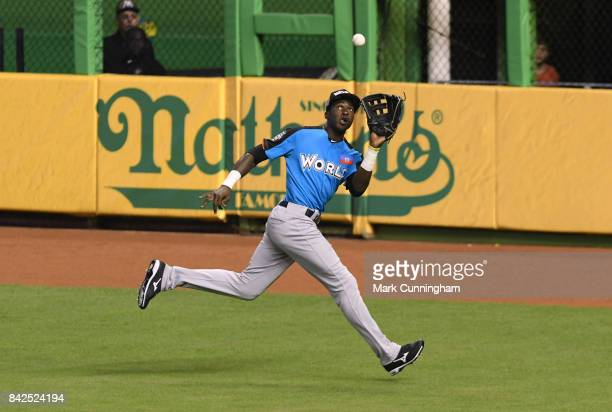 New York Yankees prospect Estevan Florial of the World Team catches a baseball during the 2017 SiriusXM AllStar Futures Game at Marlins Park on July...