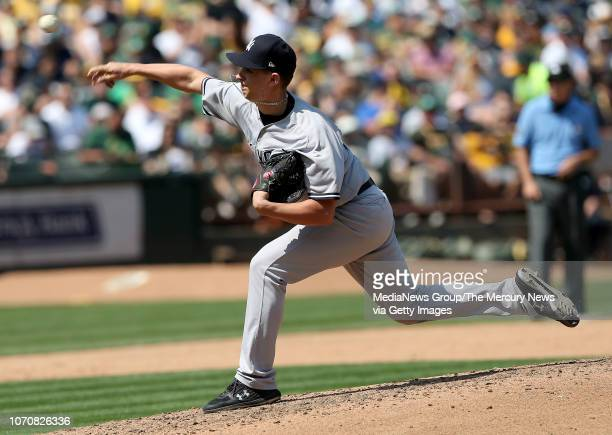 New York Yankees relief pitcher AJ Cole throws against the Oakland Athletics in the fourth inning of their MLB game at the Coliseum in Oakland Calif...