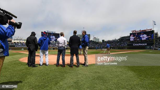 New York Yankees relief pitcher Aroldis Chapman manager Joe Maddon Jed Hoyer Thomas S Ricketts and Theo Epstein watch a video honoring Chapman prior...