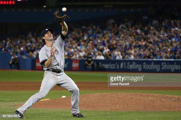 TORONTO ON AUGUST 8 New York Yankees relief pitcher Bryan Mitchell would field a Josh Donaldson chopper but fall while attempting to throw to first...
