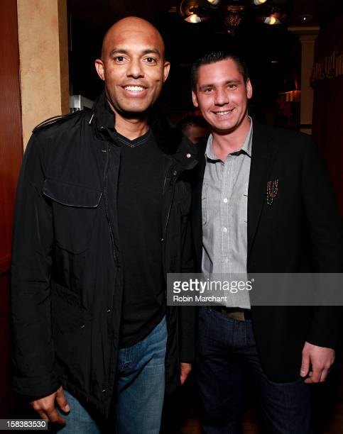 New York Yankees relief pitcher Mariano Rivera and Alex Carr attend Elvis Duran Morning Show Holiday Party at Carmine's on December 14 2012 in New...