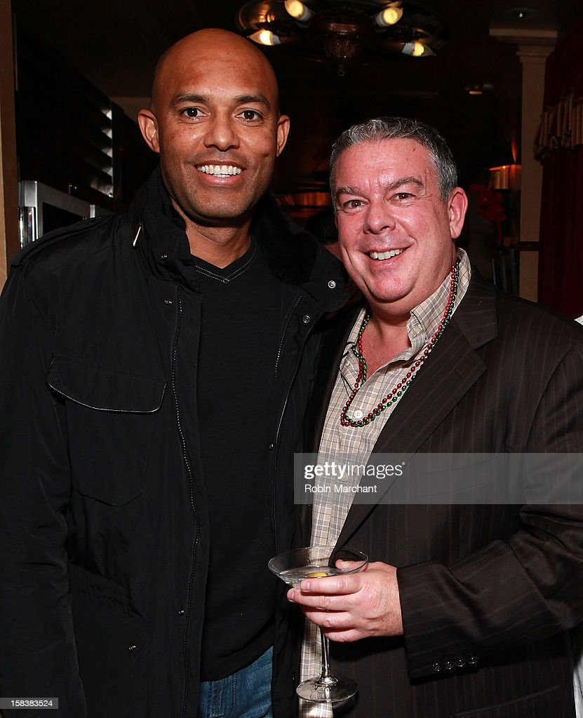New York Yankees relief pitcher Mariano Rivera (L) and Elvis Duran attend Elvis Duran Morning Show Holiday Party at Carmine's on December 14, 2012 in New York City.