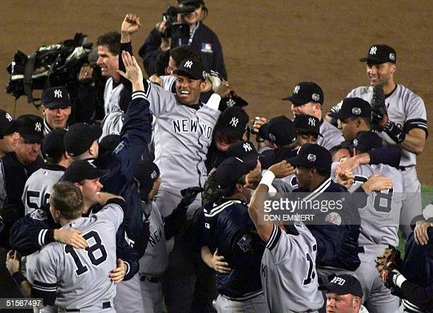 New York Yankees relief pitcher Mariano Rivera is raised in the air by teammates after they defeated the New York Mets 26 October in the World Series...