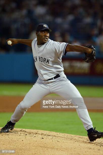 New York Yankees' reliever Jose Contreras hurls a pitch against the Florida Marlins during Game 5 of the World Series at Pro Player Stadium....