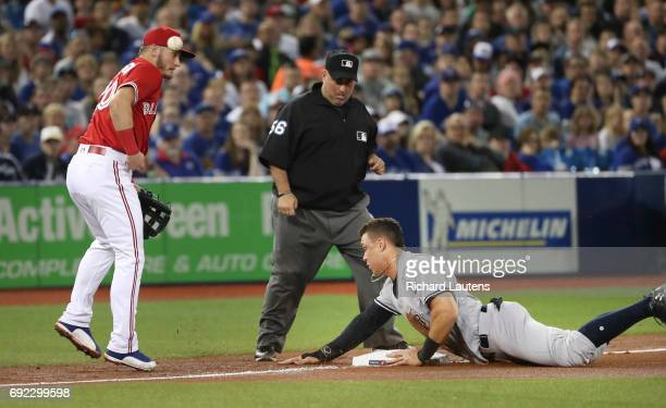TORONTO ON JUNE 4 New York Yankees right fielder Aaron Judge ends up safe on third off a throwing error in the 4th as Toronto Blue Jays third baseman...