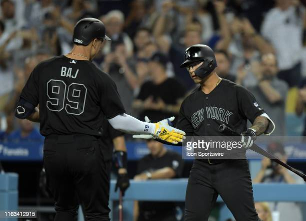 New York Yankees right fielder Aaron Judge is greeted by New York Yankees second baseman Gleyber Torres after Judge hit a solo home run in the third...