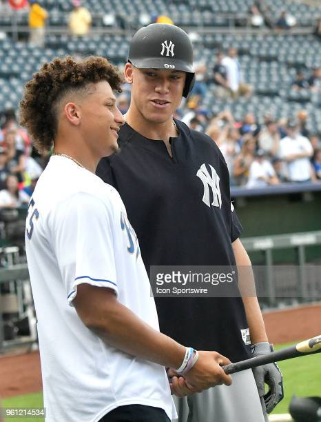 New York Yankees right fielder Aaron Judge talks with new Kansas City Chiefs quarterback Patrick Mahomes II before a Major League Baseball game...