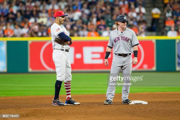 New York Yankees right fielder Clint Frazier first MLB hit and double talks to Houston Astros shortstop Carlos Correa in the sixth inning of a MLB...