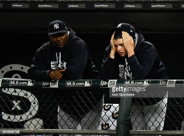 New York Yankees right fielder Dustin Fowler team mates reacts after he injured his leg chasing down a foul ball during the game between the New York...
