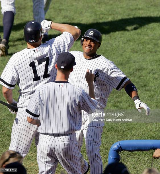 New York Yankees' Robinson Cano is congratulated by teammate Shelley Duncan after hitting a tworun homer in the eighth inning of a game against the...