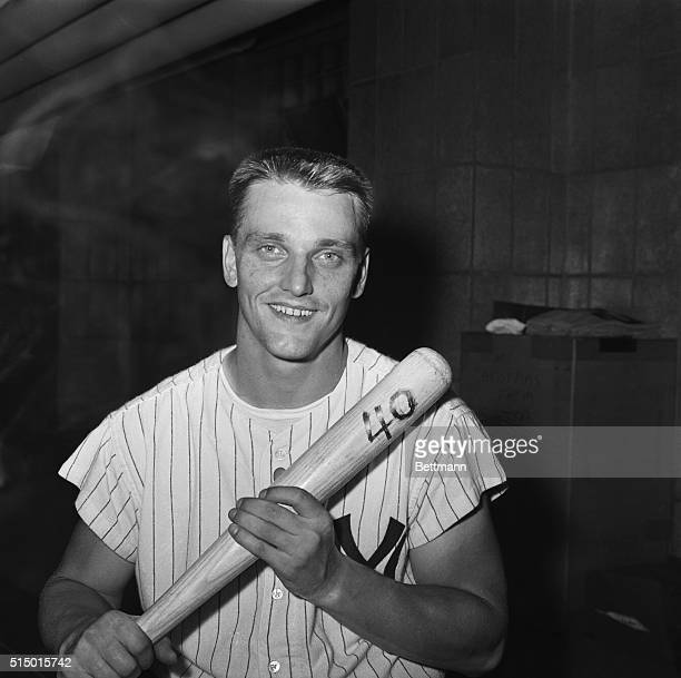 New York Yankees Rodger Maris holds the bat with a big number 40 marked on it in the dressing room at Yankee Stadium in New York City on July 25...