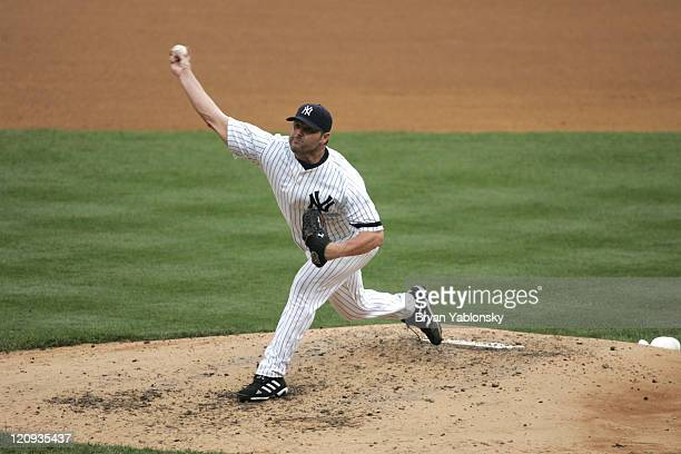 New York Yankees Roger Clemens pitching in a regular season game against the Pittsburgh Pirates played at Yankee Stadium in the Bronx NY Yankees...